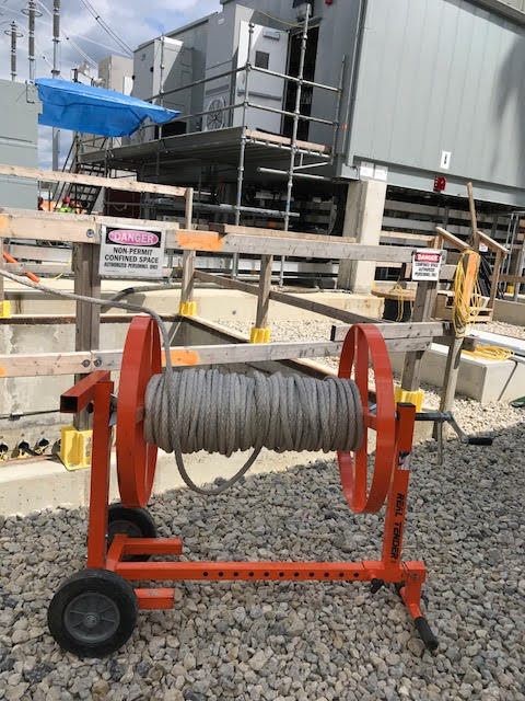 Rope tender - the iTOOLco Real Tender on the jobsite for a wire pull